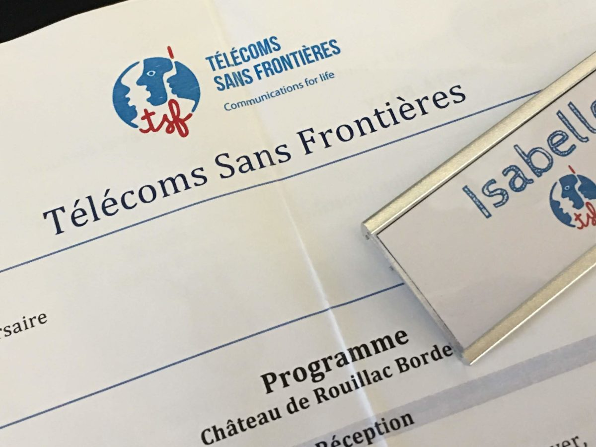 Télécoms Sans Frontières - programme and badge for the 20th anniversary